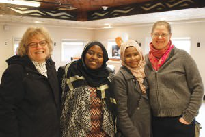 Human Solutions staffers Fran Weick, from left, Amal Ahmed, Ayan Abdiyo, and Laura Lirette celebrate the opening of the new permanent Emergency Family Shelter at 16015 S.E. Stark St. COURTESY ANGELA TAYLOR