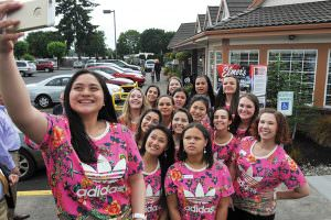 Last month, after a morning serving customers at the Elmer's restaurant in Parkrose, Rose Festival Princess Abigail Reyes Santiago takes a selfie with her sister princesses posing in the background. The 15-member court was at the restaurant promoting the Rose Meal, a collaboration between Elmer's and the Rose Festival, which raises money for the Rose Festival Foundation. STAFF/2016