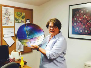 """Judy Alley, SnowCap executive director, displays the 2015 Food Hero Innovation Award presented to her by the Oregon Food Bank last month. Alley described the bowl as """"a beautiful thing"""" that to her signifies not only feeding the hungry but also the importance of bringing people together around a meal. COURTESY SNOWCAP"""