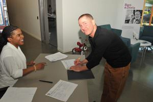 Last month at the Portland Housing Bureau and Portland Development Commission's Gateway Affordable Housing meeting, Letimya Clayton, PHB administrative services manager, has resident Chris Masciocchi sign in. STAFF/2016