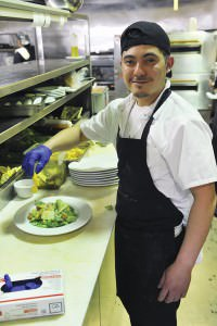 Bistro 23 Chef Alan Pacheco creates fresh fare in the food preparation area of the restaurant's spacious kitchen located behind the checkout stand. staff 2016