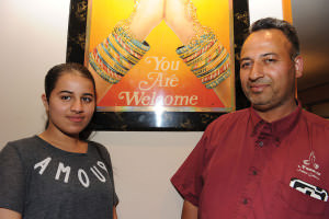 Harjinder Chand, who owns three Namaste Indian Cuisine restaurants, planned to open his fourth in October in his recently purchased building in Gateway; however, city requirements for road and sidewalk improvements in and around the former Wunderland Arcade site have slowed renovation plans. In July, Chand posed with daughter Gurpinder Dhillon at the Parkrose location. STAFF/2015 <br /> STAFF/2015