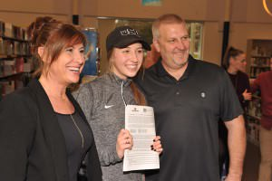 Jada Krening, flanked by proud parents Jeannie and Mark, is all smiles on National Letter of Intent day after signing a commitment to Oregon State University in front of coaches, friends, teachers and family. STAFF/2016