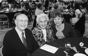Grant writer Fred Kramer, left, with wife Eunice and daughter Debbie after hearing announcement of a $10,000 grant for Trinity Lutheran Church's food pantry. COURTESY LISA NOREEN