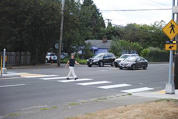 As officials dedicated the new rapid flash beacons, Portland Police and the Portland Bureau of Transportation held a crosswalk enforcement action to highlight pedestrian safety at the crossing on Southeast Stark Street at 113th Avenue.
